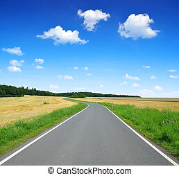 Asphalted road with blue sky