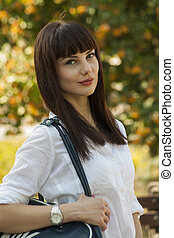 beautiful girl with atheletic bag - portrait of the...