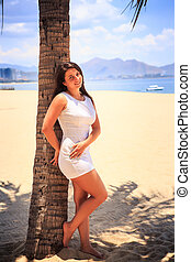 european brunette girl with big bust in white frock stand...