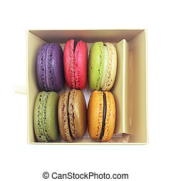 Tasty colorful macaroon in box paper on white background