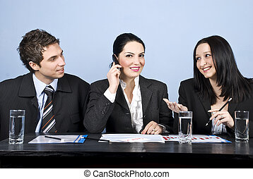 Business people meeting - Three business people having a...