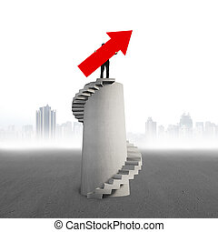 Businessman holding red arrow sign on concrete spiral tower