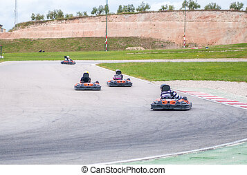 Karting race - Group of karting racer in a circuit