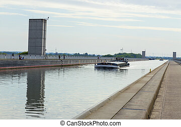 Cargo ship on the channel - Cargo ship on the bridge of the...