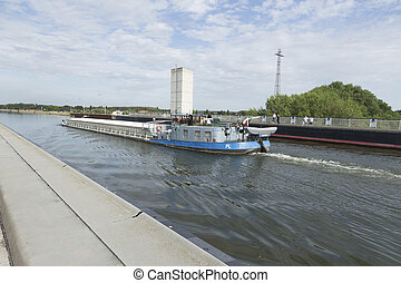 Cargo ship on the bridge - Polish freighter on the bridge of...