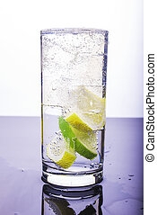 Soda with lemon and lime in the glass