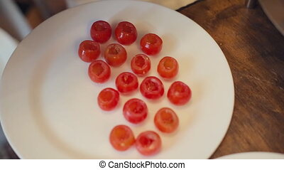 Cook prepares cherry tomatoes to stuffing in a restaurant -...