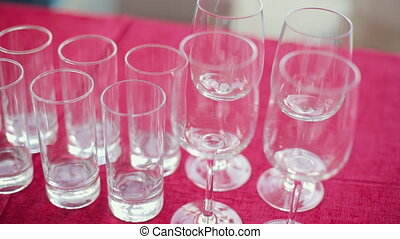 Empty wine and water glasses at a banquet