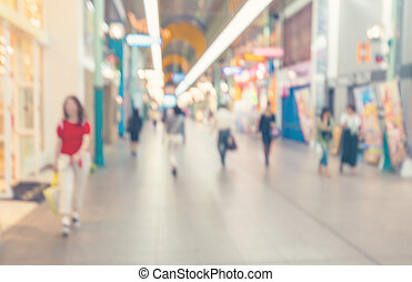 Defocused shopping mall with people walking - Blurred...
