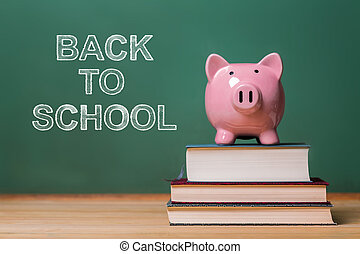 Back to School message with pink piggy bank on top of books