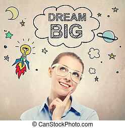 Dream Big idea sketch with young business woman wearing...