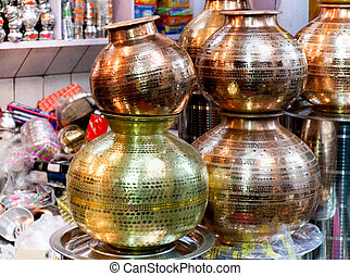 Metal pots in a shop