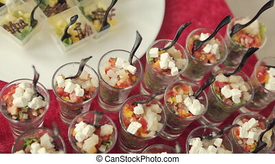 Appetizing vegetable salad in individual containers on the...