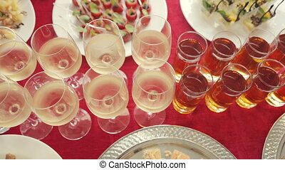 Row of glasses of alcohol and juice, a wide variety of...