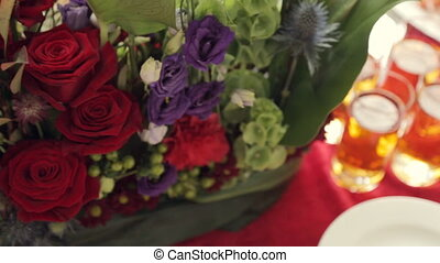 Catering. The composition of flowers, vegetables on the dishes and drinks in glasses