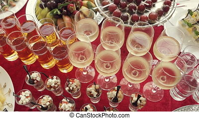 Alcohol in the glasses, juice, salads, canapés and fruit for...