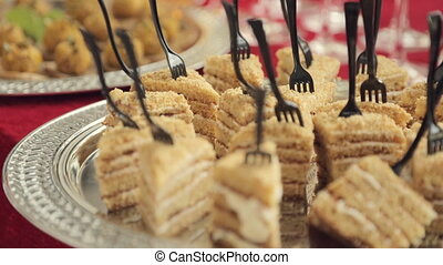Appetizing pieces of cake on catering