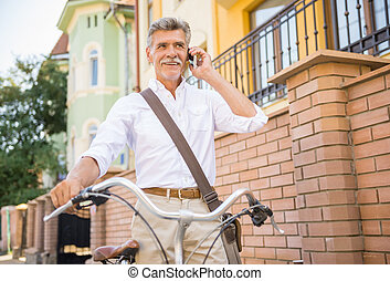 Senior man with bicycle