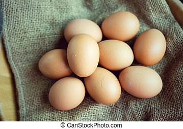 Fresh egg from a chicken farm, put on sackcloth brown.