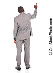 rear view of african american businessman pointing