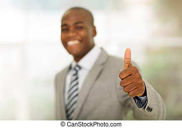 thumb up - african business man giving thumb up