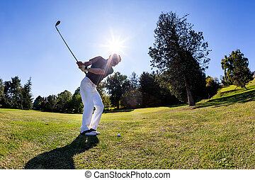 Golf sport: golfer hits a shoot from the fairway