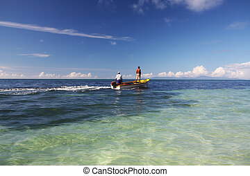 Seychelles Fisherman - Two fishermen on a boat in Seychelles...