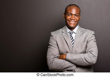 young afro american business man looking at the camera -...