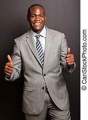 young african american man giving thumbs up