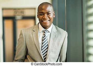 african business executive looking at the camera