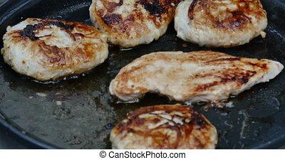 frying meat in a pan 4k