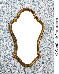 Mirror on Wall - Golden-framed mirror on wallpapered wall...
