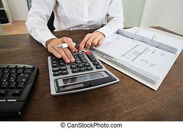 Businessperson Calculating Financial Expenses - Close-up Of...