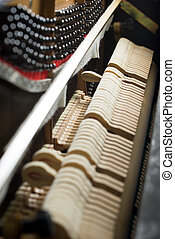 Inside a piano - Close up of hammers striking strings inside...
