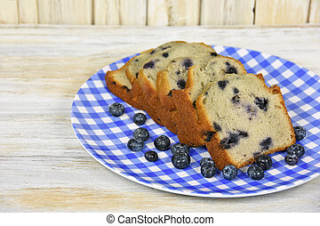 blueberry bread - Slices of blueberry bread with ripe...