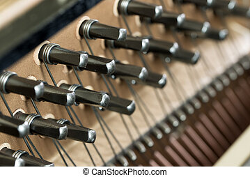 Piano wire - Close up of piano strings forming background