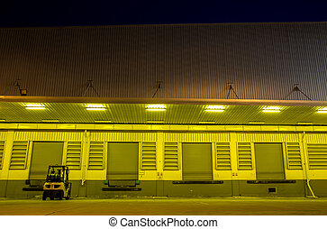 Warehouse with yellow lights at night