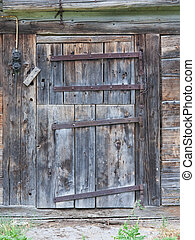 Old door in a wooden shed, Switzerland