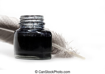 inkwell and quill - feather quill and inkwell over white...
