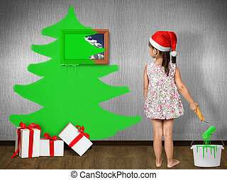Funny child girl dressed Santa hat, draws Christmas tree on wall at home, xmas concept