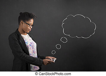African woman with tablet and speech or thought clouds on...