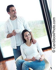 relaxed young couple drink first morning coffee - relaxet...