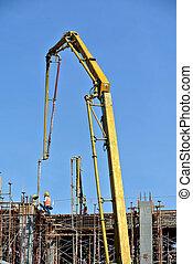 Concrete Pump Crane - Construction workers using concrete...