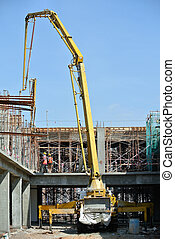 Concrete Pump Crane - Construction workers using concrete...