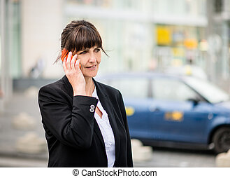 Senior business woman on phone