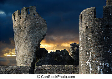 spooky castle - Spooky ruined castle lit by sunset and...