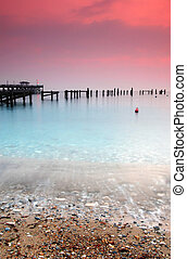 Swanage pier - The old and new Swanage Piers at sunrise -...