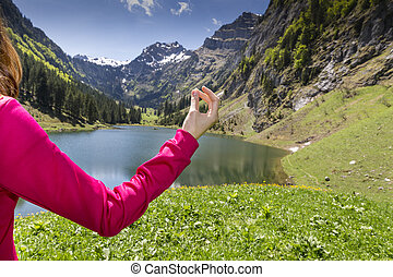 Meditation in nature - Womans arm during meditation,...