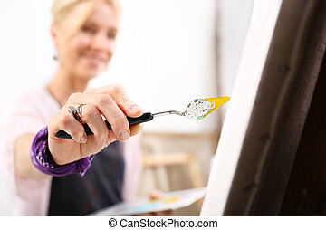 artist  - An artist in front of the easel