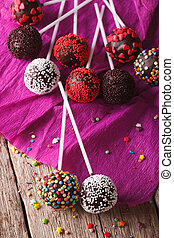 Chocolate cake pops with candy sprinkles closeup on an...